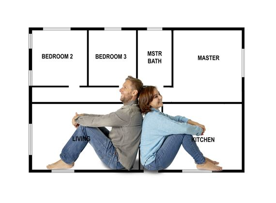 Buying your first home: a couple imagines the floor plan of their new home.